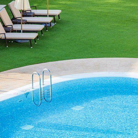 turf next to swimming pools