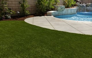 Natural Grass vs Artificial Grass Around Your Pool