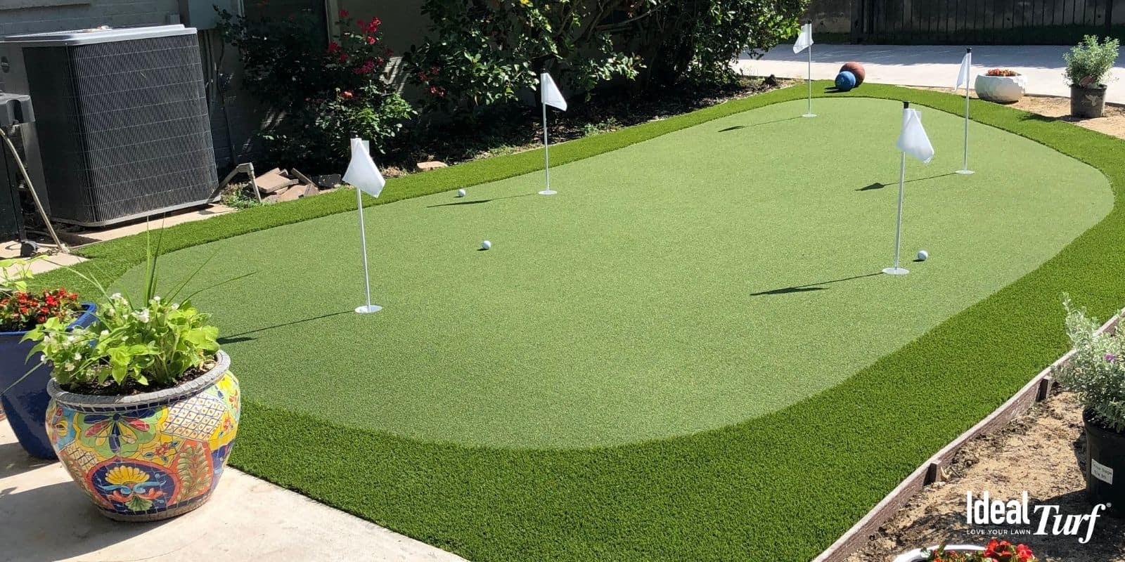 2. Man Using Backyard Putting Green