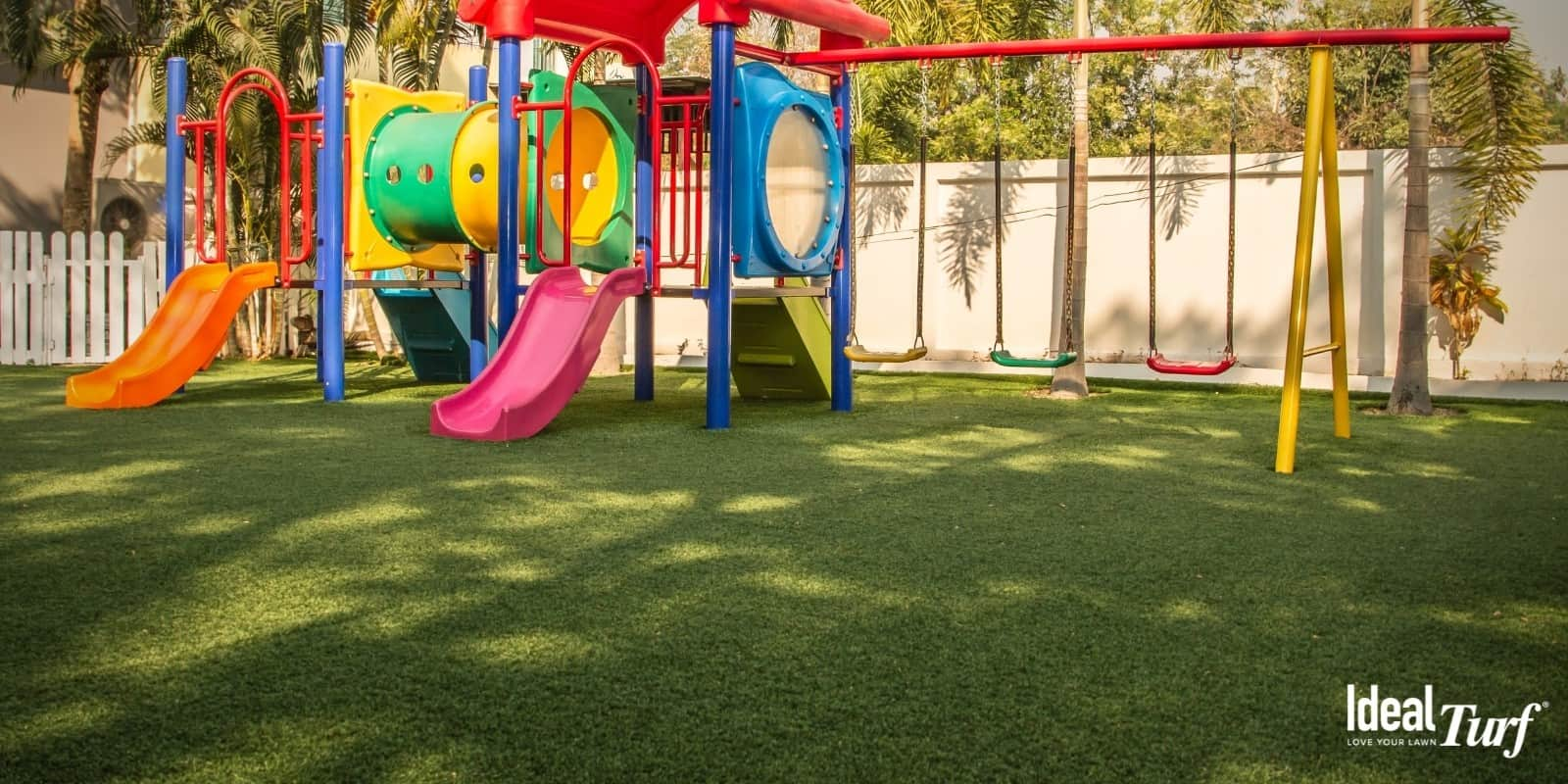 Playground with swing set and artificial grass