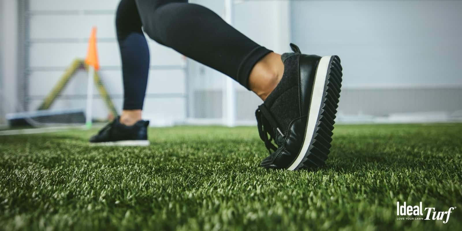 Woman's feet on artificial grass in gym