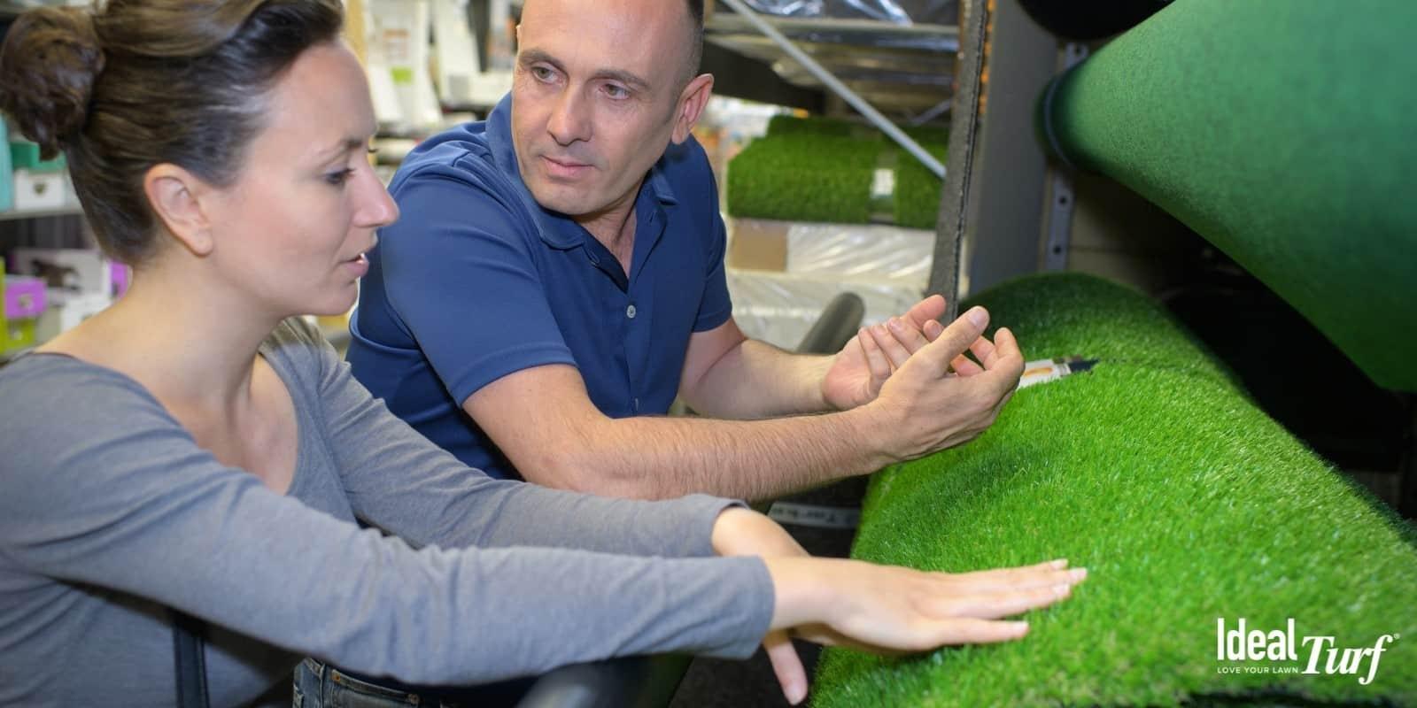Woman touching roll of artificial grass