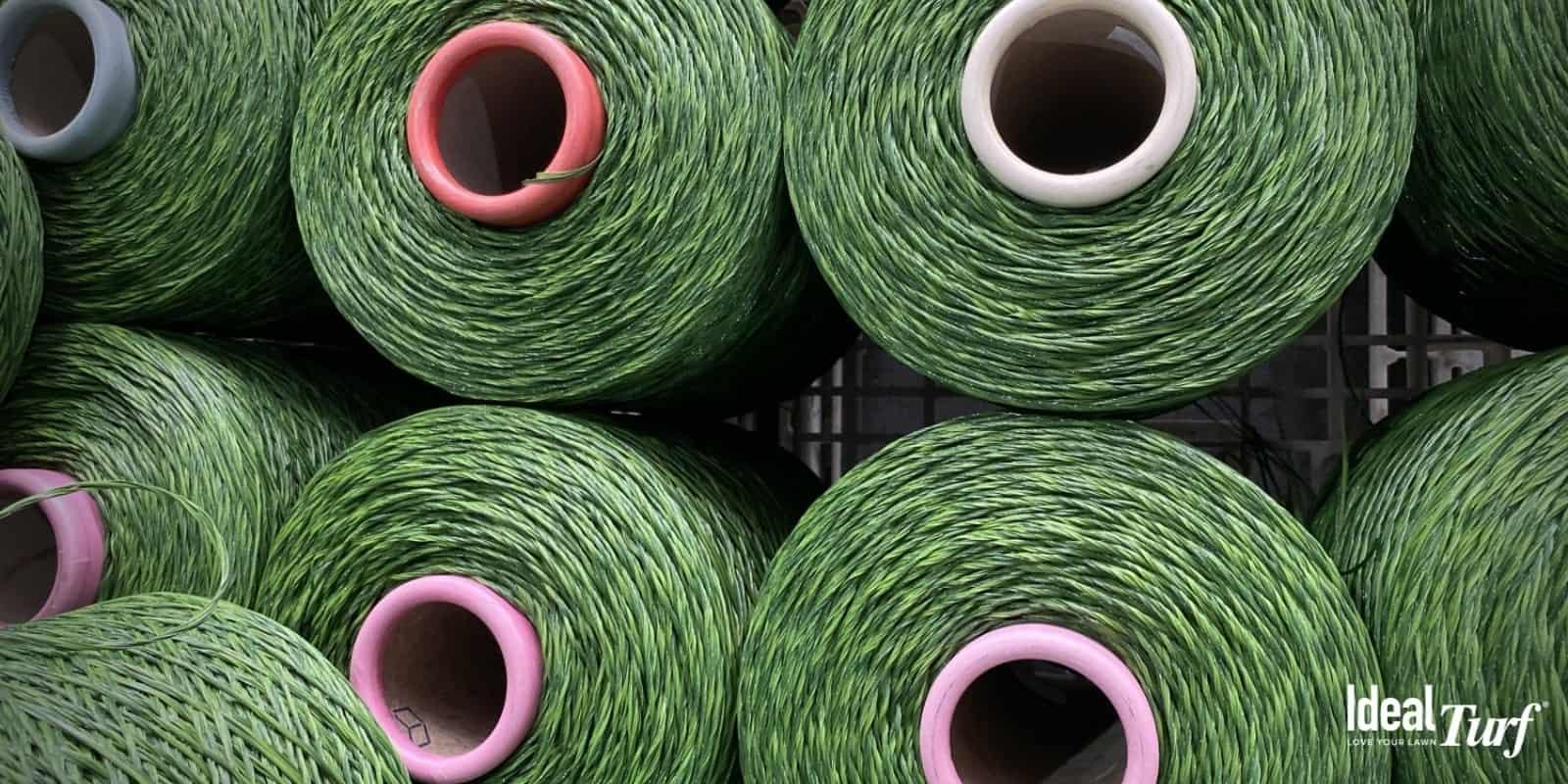 Large spools of turf yarn fibers