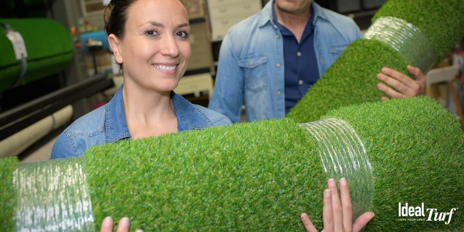 Couple deciding that artificial grass is worth the money