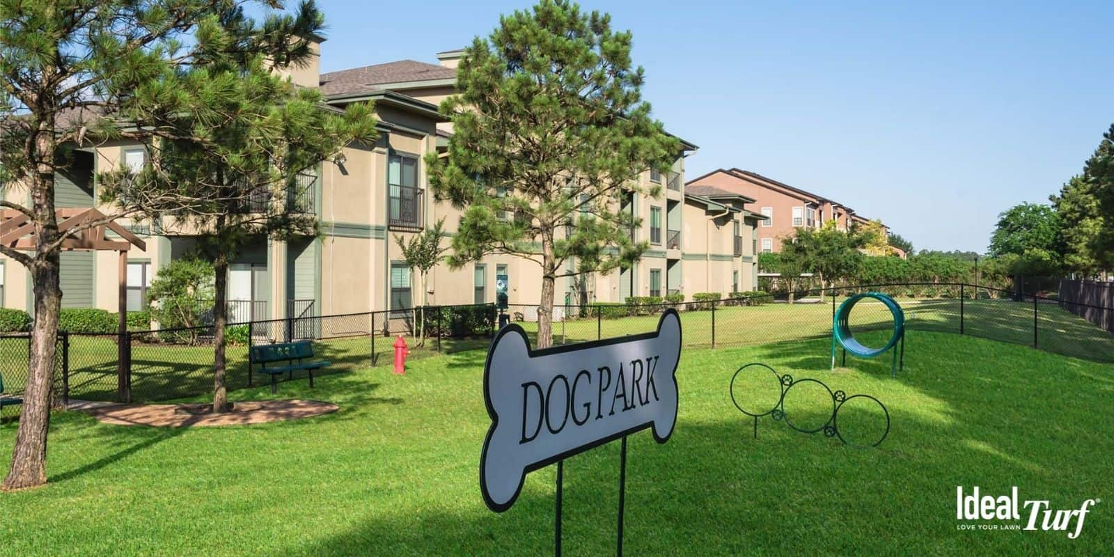 Dog park at apartment complex with artificial grass ground cover
