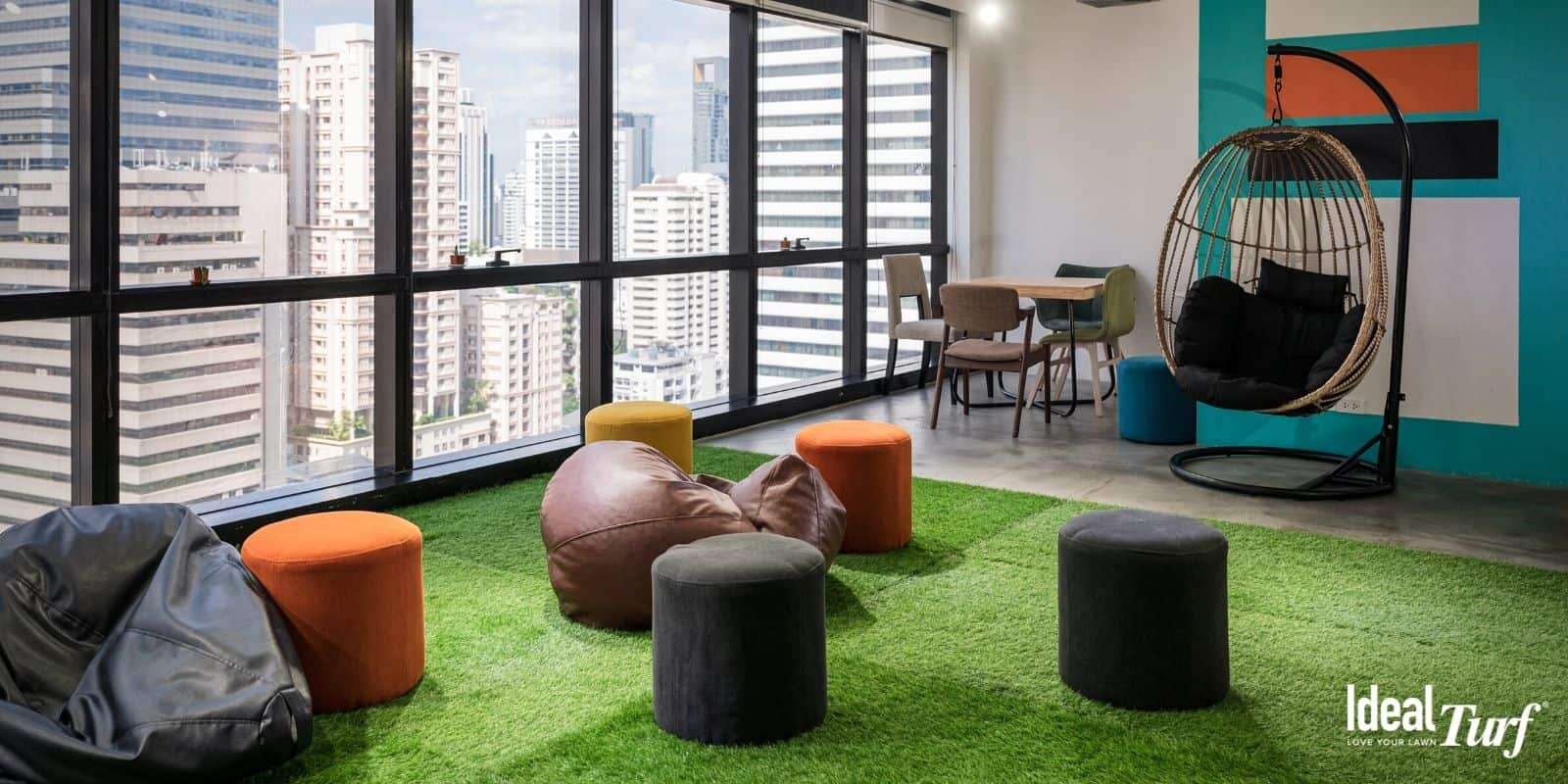Office space with artificial grass on floor